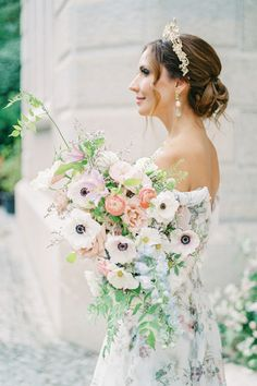 """From the editorial """"Get Transported To A Portuguese Villa For This Celebration Of Spring"""". LBB photographer @dianesoterophoto says, """"We wanted to bring spring itself into each element and detail, which guided us throughout these @moniquehuillierbride floral-filled gowns in so many different colors and textures and the flower earrings."""" 