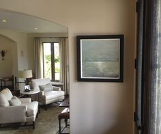 This sumptuous painting of the Pacific Ocean fits swimmingly in a coastal interior..Art Consultant - Paragone Gallery. Interior Design - Norman Design Group.