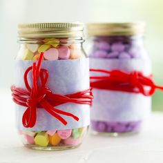 Candy Jars  Perfect for candy lovers! Dress up a jar of candy with even more candy.  Wrap red pull-and-peel candy around the jar over the paper. Tie the candy ends.
