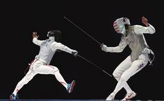 Yuki Ota (left) lunges at Alexander Massialas of the United States in the men's foil final at the World Fencing Championships on Thursday in Moscow. Ota, a native of Shiga Prefecture, defeated Massialas 15-10 to capture the gold medal, giving Japan its first-ever title at the sport's world championships. | REUTERS