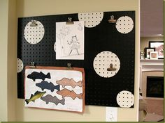 """Disguise"" pegboard with thios paint idea. Another, simpler idea? ADD ""holes"" by dipping a pencil eraser-ends on slightly lighter, and slightly darker, paint, and stipple away, so the pegboard hole regularity is understated, says TGtbT.com"
