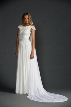 Stunning boat neck French lace wedding dress with beautiful capped sleeves and dreamy soft silk chiffon skirt