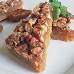 "Maple Pecan Shortbread Squares | ""These are absolutely delicious bars! The amount of pecans is perfect, the filling was just slightly gooey, and the shortbread base is so buttery and delicious. """