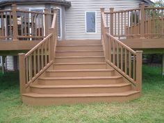 Flared deck stairs! http://www.rocksolidbuildersinc.com/trex_decks_gallery.html#