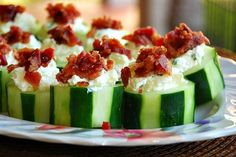 Stuffed Cucumber Cups - Cucumber stuffed with cheese/garlic mixture and topped with bacon bits.
