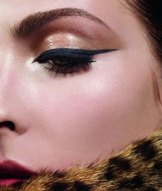 Dior's Autumn 2012 make-up look: Golden Jungle, just hope thats not real fur- otherwise love this look!