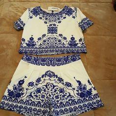 Lace Print Short Set Lace Print  Short sleeves  Keyhole button closure  Front shorts pocket Shorts