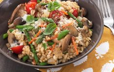 Asparagus Mushroom Risotto Recipe: Continuous stirring releases the starch from the short, round grains of Italian Arborio rice giving the risotto its characteristic creamy texture.