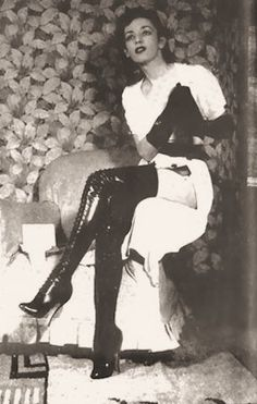 Holly Faram modelling Achilles' fetish boots by John Willie, 1930s from vintage spankings