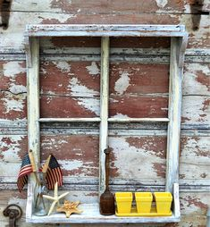 Once you have added your shelf onto your old window, go over the whole piece with some paint and then sandpaper to give it a distressed look.
