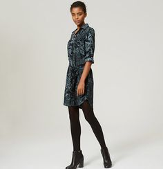"""In dreamy twilight florals, a slouchy shirtdress evokes easy allure. Collared. Long sleeves. Button front. Flap patch pockets. Roll cuffs. Removable waist tie. Back yoke. Hi-lo vented shirttail hem. 22 1/2"""" from natural waist."""