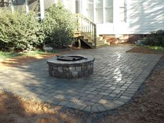 Paver patio + firepit - would love this off the back deck.