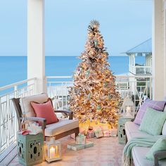 Christmas Tree on Porch. in Florida Home via Coastal Living: Beach House Christmas Home Tour.