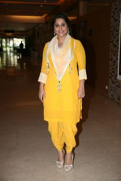 Vidya Balan wearing the Nikasha Dhoti and kurta set in mango with a printed scarf