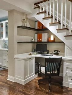 Workstation under stairs. Perfect use of space for a basement remodel or family room!