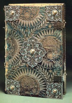 Gospel Cover with filigree apron (the contribution of Prince Repnin to the Holy Trinity Monastery in 1695). Apron - silver, filigree, enamel on filigree. Ancient Book Covers as Russian Jewelry Art,...