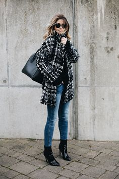 Emma Hill wears monochrome oversized tweed coat, ripped skinny jeans, black vinyl patent pic ankle boots, black studded Givenchy Antigona medium, chic winter outfit