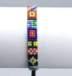 Colorful beaded loom bracelet. This bracelet is made out of tiny Japanese Miyuki Delica beads. Wrist size 17 -18cm (6.5 - 7 inches) Width - 7mm Worn alone or layered with your wath this bracelet makes a cute addition and compliments any look, for day or night. Perfect unisex gift for