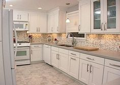 white- kitchen-metal- backsplash