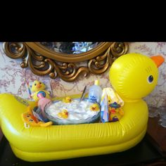 I used the Pinterest punch idea and put it in this Rubber Duck bathtub for a baby shower. The Mommy to be also got a neat little gift!