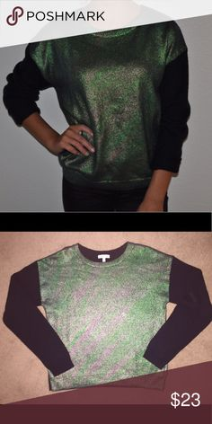 Metallic Green/Gold Shiny Sweater This sweater is unique changing colors with the light from green to teal to gold to silver. Lightweight with black sleeves, purchased from Nordstrom, worn 1-2 times, almost perfect condition Nordstrom Sweaters Crew & Scoop Necks