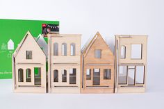 These modern wooden toy houses would be fun to decorate.