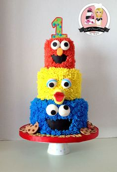 3 Tier Sesame Street Birthday Cake Buttercream cake with fondant eyes/mouths. I am so pleased with how this turned out! TFL!