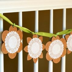 Doily banner -- doilies, chipboard shapes (I see these in all flavors at Michael's), and Mod Podge. Easy peasy.