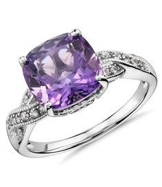 This ring features a stylish cushion-cut amethyst gemstone complimented with white sapphires framed in a sterling silver twist design.