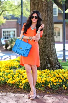 Crepe Shift Dress Orange crepe shift dress...classy especially with the statement necklace