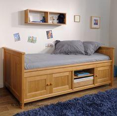 jual Desain Tempat Tidur Anak Modern Kayu Jati sebagai material utama, dipan multifungsi untuk anak dengan rak bukui di dalmnhya, terdapat pintu lengkap
