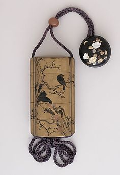 Takenaga (Japan, Edo)   Inro, Ojime, Netsuke, early 19th century  Costume/clothing accessory/waistwear, Four-case inro with design of five crows in sumi-e togidashi on kinji ground; coral bead ojime; wood manju in Shibayama style with mother-of-pearl