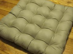 Large Organic Dog Bed - Washable    This large dog bed measures 34 by 37 on the outer edges and stands about 6 high. This plush futon-style bed