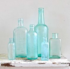 vintage-aqua-glass-embossed-instant-bottle-collection-by-marybethhale-on-etsy - Showcse Colored Glass Bottles, Antique Glass Bottles, Blue Bottle, Vintage Bottles, Bottles And Jars, Glass Jars, Perfume Bottles, Vintage Perfume, Coloured Glass