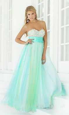 I really love these teal and turquoise dresses! Especially this one with the hint of green and yellow!