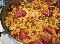 Chicken and Sausage Jambalaya! We learned to make this at the Jackson Square Cooking School on our honeymoon. We love Jambalaya! Potluck Dishes, Potluck Recipes, Food Dishes, Great Recipes, Dinner Recipes, Cooking Recipes, Favorite Recipes, Donut Recipes, Cajun Dishes