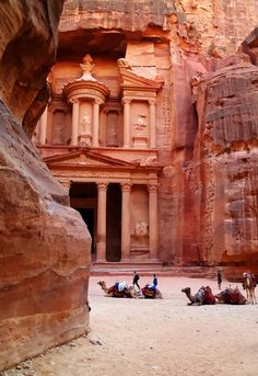 Petra, Jordan.  Compare the size of the men and camels to the size of the entrance - on entering the 'building' one sees Indiana Jones in the mind's eye and it becomes The Temple of Doom, just like the movie.