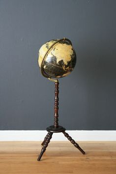 vintage globe on stand from midcenturymodernfinds.com- they're in SF