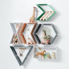 Shop Shape Shifter Wall Shelf.  The Shape Shifter Wall Shelf hinged metal wall shelves can be hung in multiple shapes like a rectangle, triangle or even an arrow.