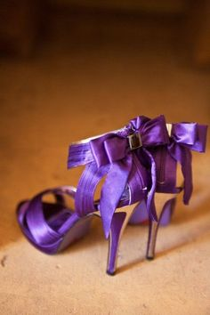 Royal purple high heels with bow detail.