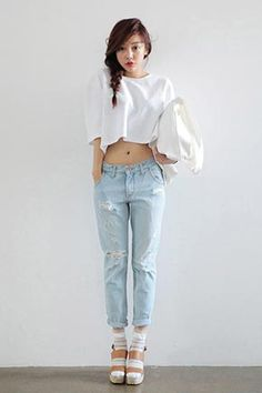 Today's Hot Pick :Distressed Light Blue Boyfriend Jeans http://fashionstylep.com/SFSELFAA0034449/stylenandaen/out Whether you are kicking back in your casuals or dolled up for a night out, this pair of boyfriend jeans is the perfect mannish denims by night, by day, and for play. It comes with a button-and-zip fly closure, belt loops, four pocket style, tapered leg style with cropped raw-edged hems. Style with a loose-fit crop top and strap sandal heels.