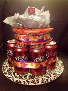Birthday cake made with favorite soda, candy and bottle of alcohol used as the center support