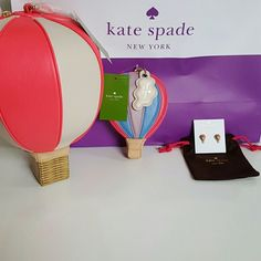 My Kate Spade Get Carried Away Collection! This is my lovely collection of Kate Spades Get Carried Away Hot Air Balloon wristlet, coin purse and earrings. These are 14k gold plated lovely purple blue and pink colors. All brand new unused and with retail tags attached. kate spade Bags Clutches & Wristlets