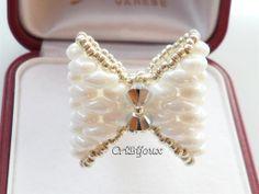 Anello A145a#anello #anellli #bague #ring# swarovski #anellohandmade #anelloswarovski #bijoux #gioielli #anelloperline  #boemia #cristalli #cribijoux  #bijoux #gioielli #superduo #anellosuperduo #fiocco #anellofiocco