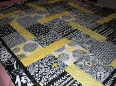 Yellow, black, and white quilt