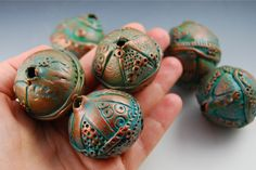 they look ancient - love them...   big hollow polymer clay beads that were inspired by Marie Gibbons ceramics