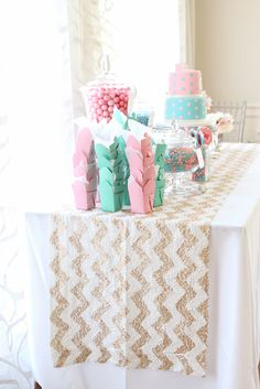 Candy bar with cute pink and mint takeout boxes to store sweet treats! Love the gold and cream chevron sequin table linen! #entertaining #candybar