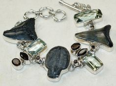 Shark Teeth bracelet designed and created by Sizzling Silver. Please visit www.sizzlingsilver.com. Product code: BR-8486