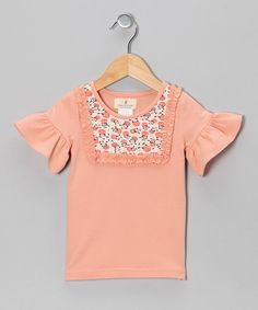 With ruffled sleeves and a fancy floral-printed collar, this tee shines with girlish whimsy. The soft, stretchy cotton fabric adds an extra dash of comfort and convenience.95% cotton / 5% elastaneMachine wash; hang dryImported