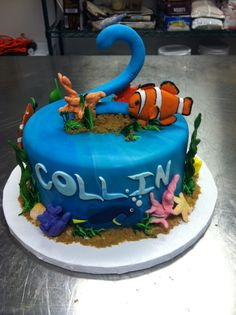 tropical fish cake with all hand made sugar pieces.  www.nadiacakes.com